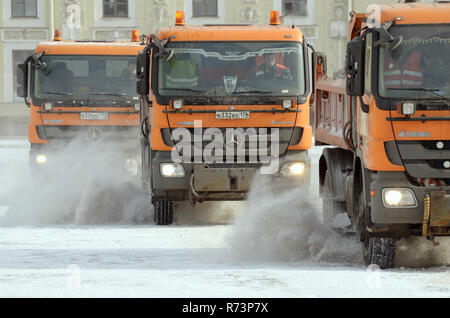 Saint-Petersburg.Russia.March.18.2018.Night in the city the snow fell.His cleaning went snow-removal vehicles.They cleared the roads on the streets of - Stock Photo