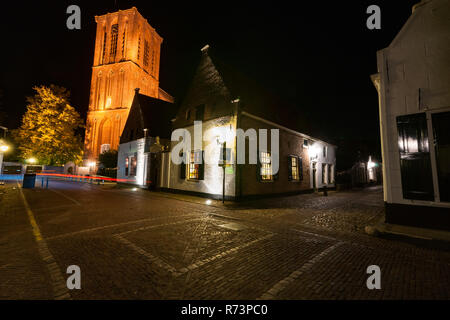 A typical Dutch church with flat roof in the old fortified Dutch city. A beautiful evening photo with long shutter speed created at the blue hour afte - Stock Photo