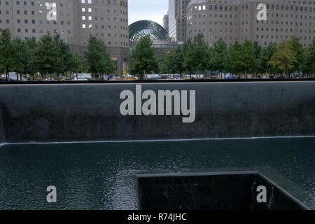 Fountain with a waterfall. Walking through the streets of New York, Manhattan. The life of New York in the afternoon. Streets and city buildings. - Stock Photo