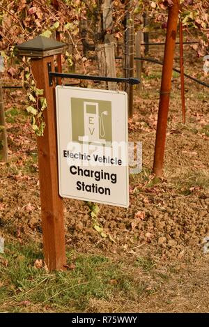 Sign for Electric Vehicle Charging Station with EV parking spaces, in vineyard along road to Quivira Vineyards, Healdsburg, CA, USA - Stock Photo
