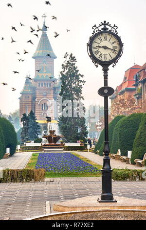 City Clock and Orthodox Cathedral, Victory Square, Timisoara, Romania - Stock Photo