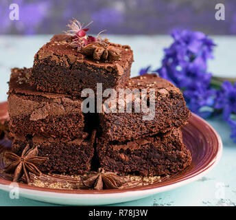 pile of square baked pieces of chocolate Brownie cake - Stock Photo