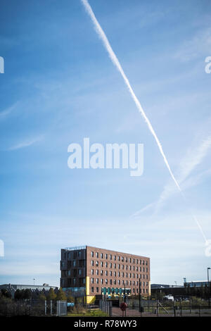 An modern office block stands  surrounded by older low rise buildings in Cardiff, Wales, UK - Stock Photo