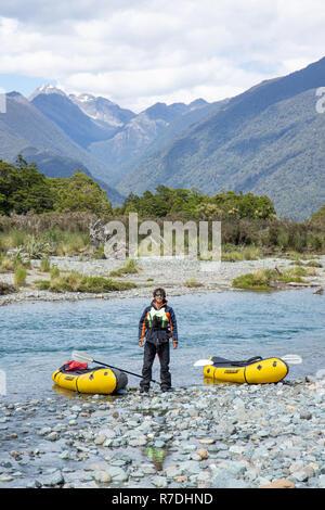 Packrafting in Fiordland National Park, New Zealand - Stock Photo