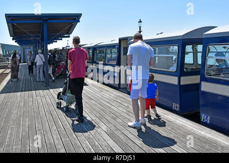 Famous Thames Estuary Southend Pier Head public transport train railway station passengers on platform returning to Southend on Sea Essex England UK - Stock Photo