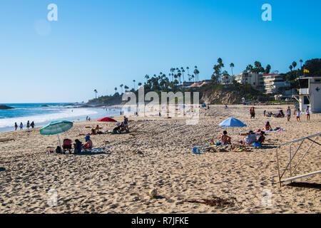 Laguna Beach, California - October 9, 2018: Tourists are seen enjoying the beautiful and famous Laguna Beach on this date - Stock Photo