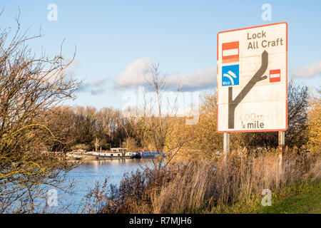 Inland waterway navigation sign showing a lock and weir on the River Trent at Holme Pierpont, Nottinghamshire, England, UK - Stock Photo