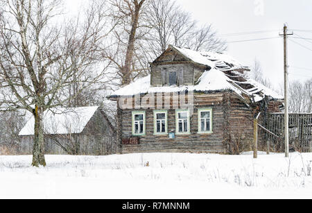 Destroyed wooden house - Stock Photo