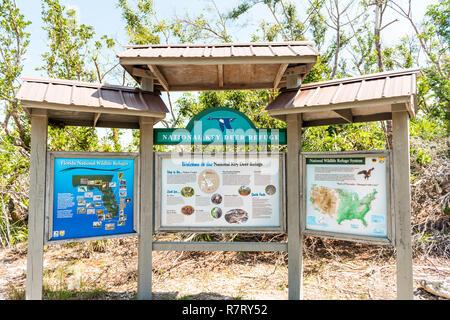 Big Pine Key, USA - May 1, 2018: Florida Keys, closeup of blue lake pond information sign for National Key Deer Refuge - Stock Photo