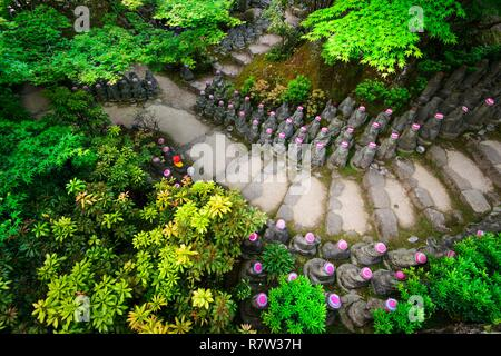 Japan, Honshu island, Hiroshima prefecture, Miyajima island, Bouddha statues leading to the Daisho-in temple on Miyajima island - Stock Photo