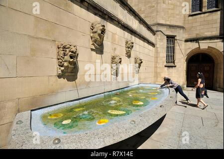 Luxembourg, Luxembourg city, forecourt of the Notre Dame de Luxembourg cathedral, fountain with animal faces and floral sculptures by the Luxembourg painter-sculptor Jean Curot (1882-1954) - Stock Photo