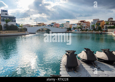 Beautiful Marina in the city of Limassol in Cyprus with jet ski's in the foreground and luxury residences in the background. It comprises a newly deve - Stock Photo