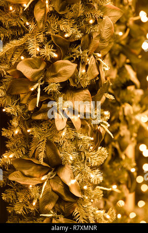 Beautiful colorful Christmas holiday backdrop image with lights, leaves and Christmas tree branches - Stock Photo