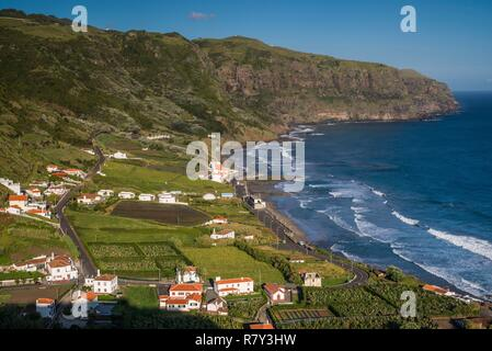 Portugal, Azores, Santa Maria Island, Praia, elevated view of town and Praia Formosa beach, late afternoon - Stock Photo