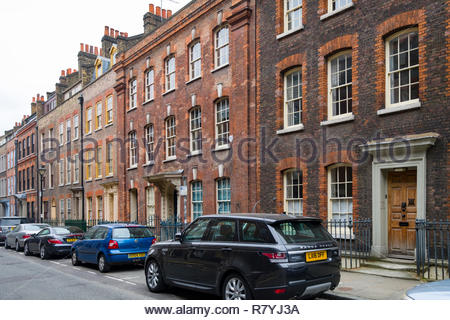 Terraced houses along Fournier Street, Tower Hamlets, London, England, United Kingdom - Stock Photo