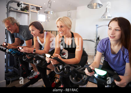 Group Taking Spin Class In Gym - Stock Photo