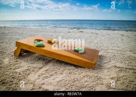 A popular game of Corn Hole in a fine weather at Fort Myers, Florida - Stock Photo