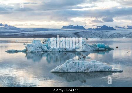 Eisbergs in quiet water of glacier lagoon Jokulsarlon in Iceland - Stock Photo