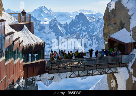 The passerelle of the Aiguille du Midi leading from the cable car to the observation desk in winter. Mont Blanc mountain range, Chamonix, Haute-Savoie - Stock Photo