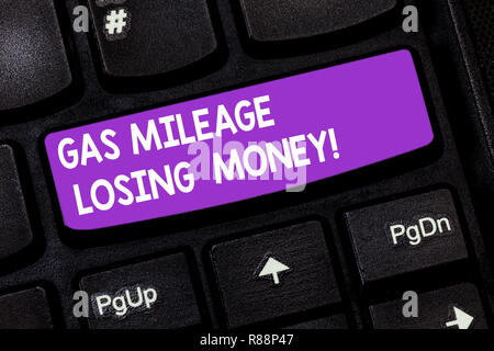 Handwriting text Gas Mileage Losing Money. Concept meaning Long road high gas fuel costs financial losses Keyboard key Intention to create computer me - Stock Photo