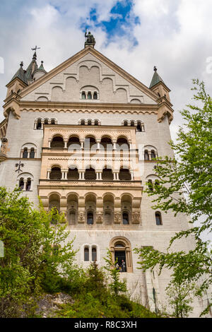 Great close low angle view of the beautiful west façade of the world famous Neuschwanstein Castle, a 19th-century Romanesque Revival palace at the... - Stock Photo