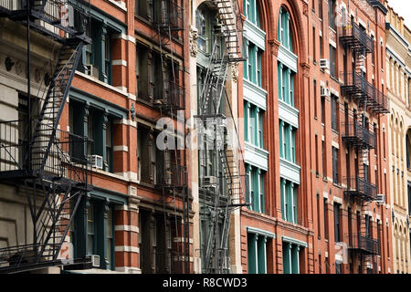 Close-up view of New York City style apartment buildings with emergency stairs along Mott Street in Chinatown neighborhood of Manhattan. - Stock Photo
