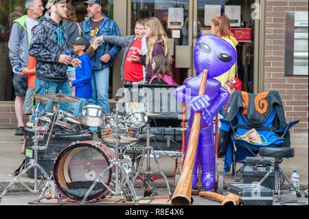 McMinnville, Oregon,USA - May 16, 2015: Portland's Marching Band, LoveBomb Go-Go, puts on a show at the Annual UFO Fest. Brass section of band perform - Stock Photo