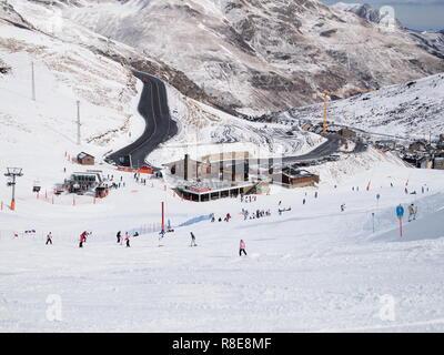 Andorra La Vella, Andorra, February 15 2011, landscape of ski resort showing mountainous terrain and skiers on the piste - Stock Photo
