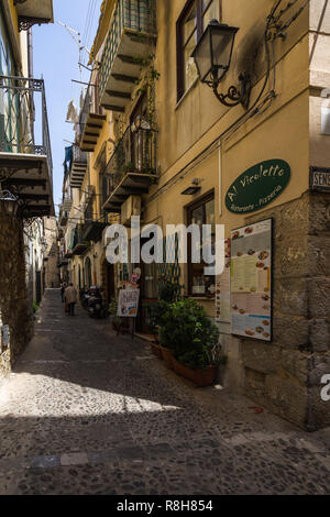 Typical narrow street in Cefalù old town. Cefalù, Palermo province, Sicily, Italy, May 2018 - Stock Photo