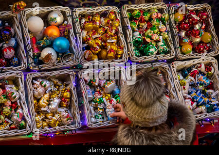 A counter with Christmas decorations for the Christmas tree in the Central store of Moscow in the new year's eve, Russia - Stock Photo