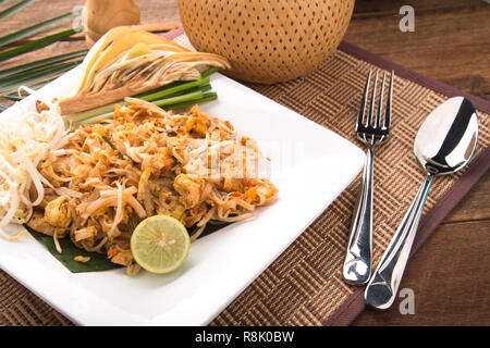 Thai Fried Noodles Pad Thai with shrimps or prawns.street food. fried noodles with chicken and shrimp - Stock Photo
