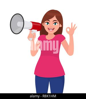 Young woman holding a megaphone/loud speaker and gesturing cool, okay/OK sign. Girl making announcement with megaphone. Megaphone and loudspeaker conc - Stock Photo