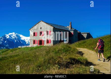 Switzerland, Valais, Tour du Mt Blanc, Trient, col de Balme, Refuge-hotel of Col de Balme and Mt Blanc in the back - Stock Photo