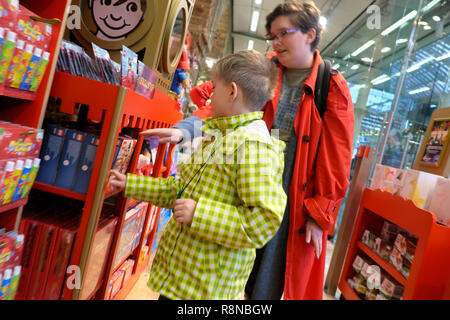 Hamleys toy shop at St Pancras Station in the Kings Cross area people customers child shopping for Lego at Christmas in London UK  KATHY DEWITT - Stock Photo