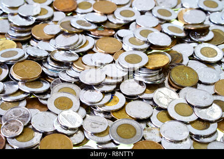 Spare change of canadian metal money spread and filling the frame. Dime, quarter, one, two dollar money. - Stock Photo