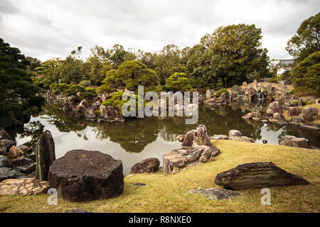 The pond and garden at the Daiunzan Ryoanji temple in Kyoto - Stock Photo