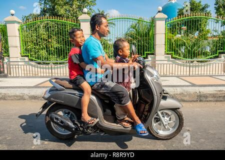 Indonesia, Lombok, family on a motorcycle - Stock Photo