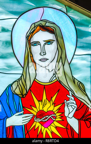 A stained glass window featuring the Virgin Mary is one of the highlights at Chapel of Mercy in Greenwood, Mississippi. - Stock Photo