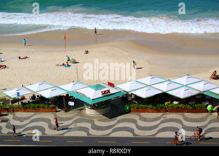 Aerial View of Copacabana Beach with Big Waves and Famous Portuguese Pavement along the Beach, Rio de Janeiro, Brazil, 22nd May 2018 - Stock Photo