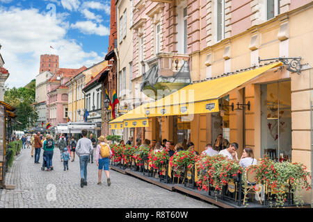 Restaurant and shops on Pilies Street (Pilies Gatvė) in the Old Town, Vilnius, Lithuania - Stock Photo