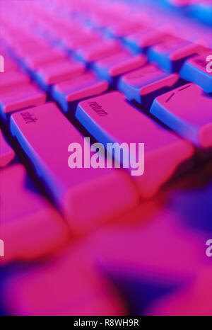 Colorful closeup of computer keyboard with the emphasize on the enter key - Stock Photo
