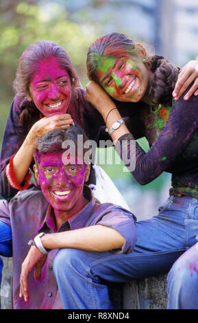 Three friends enjoying Holi Festival MR#396 - Stock Photo