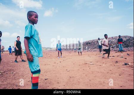 Mali, Africa - Black african children playing soccer in a rubbish dump. Rural area near Bamako - Stock Photo