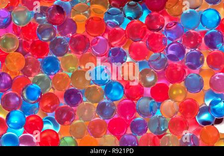 Many tiny colorful balls saturated in water. These make a good background or wallpaper for that added dash of color. - Stock Photo