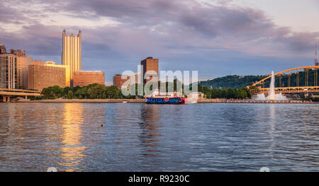 View of Pittsburgh skyline and Point State Park from the Ohio River - Stock Photo