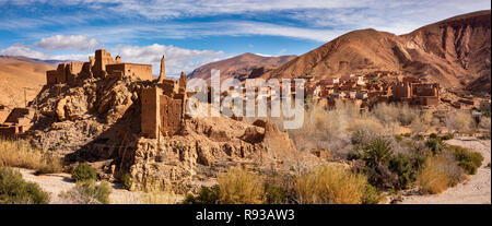 Morocco, Dades Gorge, Ait Ouglif village old mud Kasbahs near Tamellalt in High Atlas, panoramic - Stock Photo