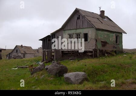 Derelict houses of a rural locality, Dalniye Zelentsy, Kola Peninsula, Kolsky District, Murmansk Oblast, Russia - Stock Photo