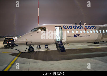 WARSAW, POLAND - CIRCA NOVEMBER, 2017: Eurolot Bombardier Q400 NextGen at Warsaw Chopin Airport. - Stock Photo