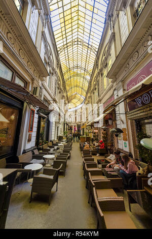 BUCHAREST, ROMANIA - DECEMBER 9: The Pasajul Macca-Vilacrosse (Macca-Vilacrosse Passage) is seen on December 9, 2018 in Bucharest, Romania. Pasajul Macca-Vilacrosse is a fork-shaped, yellow glass covered arcaded street in the Old Town. - Stock Photo