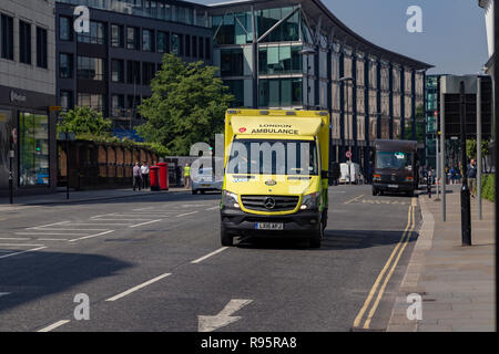NHS London UK ambulance emergency SOS call National Health Service paramedic crew on board responding 999 call driving & speeding blue flashing light - Stock Photo